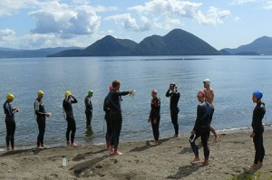 A Hong Kong triathlon team swim training at a recent triathlon camp in Lake Toya